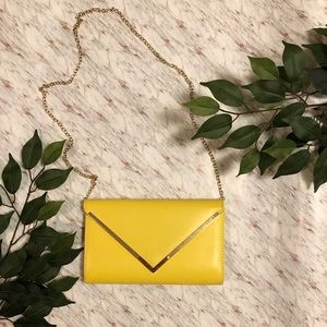 Yellow clutch and crossbody bag